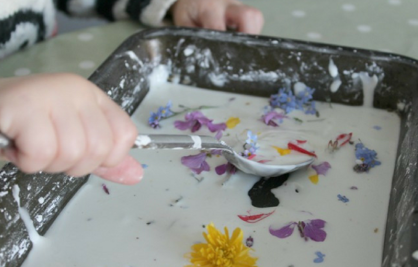 "Add flowers to this thick ""goop"" mixture then watch your little ones explore stirring and mixing up their flower concoction."