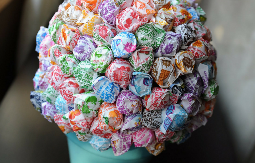 For this playful bouquet, stick lollipops into a foam ball atop a painted flowerpot. Simple!